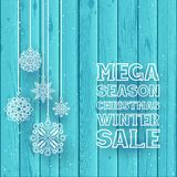 Christmas text on blue wood background. Snowfall on wood backdrop. Hanging white line snowflakes royalty free illustration