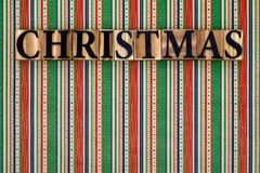 Christmas text on striped background Stock Photography