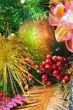Christmas Textures 4753. Christmas holiday decorations with orchid, glitter ball, berries, glitter gold fern leaf, and accents Stock Images