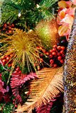 Christmas Textures 4773. Christmas holiday decorations with orchid, glitter ball, berries, glitter gold fern leaf, and accents Royalty Free Stock Images