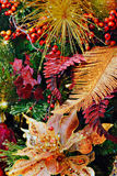 Christmas Textures 4777. Christmas holiday decorations with glitter poinsettia, berries, glitter gold fern leaf, grape leaf, and accents Stock Image