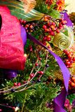 Christmas Textures 4797. Christmas holiday decorations with berries, red green purple ribbon, and accents Stock Image