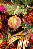 Christmas Textures 4799. Christmas holiday decorations with orchid, glitter ball ornament, berries, glitter gold fern leaf, and accents Stock Images