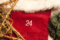 Christmas 24th december. The text 24 (december) between red, white,green and brown christmas decorations Royalty Free Stock Photography