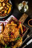 Christmas, thanksgiving food, baked roasted chicken with cranber. Ry and herbs, served with fried vegetables and sauces on dark rusty table, copy space above stock images