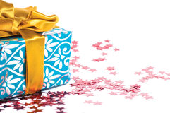 Christmas theme. Christmas gift box and red stars on the white royalty free stock images