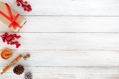 Christmas theme Background. With Christmas gif box, holly berry and decoration on white wooden board. Creative Flat layout and top view composition Royalty Free Stock Photography