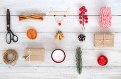 Christmas theme Background with decorations and gifts boxes on white wood board. royalty free stock photos