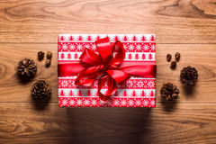 Christmas theme background, xmas present and pine cones on wooden table Royalty Free Stock Photos