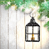 Christmas theme with black lantern on white wooden Stock Photography
