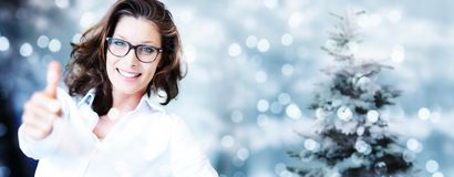 Christmas theme, business smiling woman like hand with thumb up stock photography