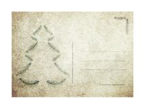 Christmas theme. Old vintage postcard with christmas tree symbol image on a white background stock images
