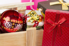 Christmas theme. Christmas tree toys with wooden box and gift boxes close up Royalty Free Stock Photos