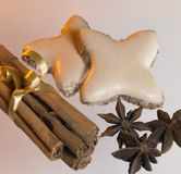 Christmas theme with cinnamon sticks, stars and spice Royalty Free Stock Image