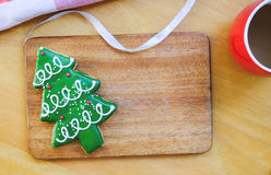 Christmas theme composition. Christmas tree cookie with coffee on wood background Royalty Free Stock Photo