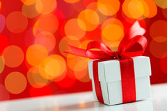 Christmas theme. Gift box with red ribbon on Christmas theme background Royalty Free Stock Images