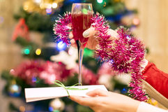Christmas theme-a glass of Red sparkling wine in a female hand Royalty Free Stock Images