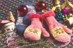 Christmas theme with jingle bells, gloves, snowman, fir tree branch Stock Photos