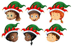 Christmas theme with kids in elf hats Royalty Free Stock Photo