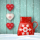 Christmas theme, red cup with cute decoration in front of blue wooden wall, illustration. Christmas theme, red cup in snow with cute decoration in front of blue Royalty Free Stock Image