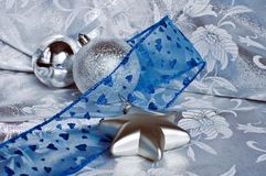 Christmas theme silver and blue. Christmas theme silver balls and star and blue bow Royalty Free Stock Photography