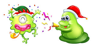 Christmas theme with two aliens in party hats Stock Photo