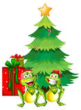 Christmas theme with two frogs and christmas tree Stock Image