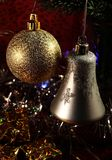 Christmas Theme. Two glass ornaments on the Christmas tree stock photo
