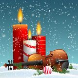 Christmas theme with violin and burning candles stock photo