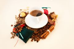 Christmas theme.White cup coffee, green and broun beans. Candid. Cup coffee, green and broun beans, Christmas theme. Candid royalty free stock images