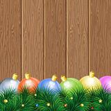 Christmas Theme. With Wooden Boards, Baubles and Fir Branches, vector background Royalty Free Stock Image