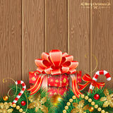 Christmas Theme. With Wooden Boards, Gift, Fir Branches, Gold Streamer and Candy, vector background Royalty Free Stock Images