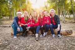 Christmas Themed Multiethnic Family Portrait Outdoors. Christmas Themed Multiethnic Family Taking a Portrait Outdoors stock photos