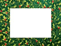 Christmas themed picture frame, holly pattern royalty free stock photos