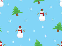 Christmas themed seamless pattern. Vector Christmas themed seamless pattern with snowman, pine trees and snow crystals in light blue background Royalty Free Stock Photo