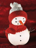 Christmas themed snow man with red scarf against Royalty Free Stock Image