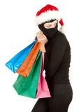 Christmas thief with stolen shopping bags Royalty Free Stock Photo