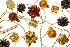 Christmas things. As ctrobiles and gold and red present and balls isolated on white royalty free stock photos