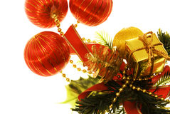 Christmas things. Gold and red present and balls isolated on white Stock Photo