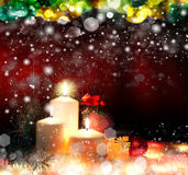 Christmas. Three candles and blue spruce Stock Photos