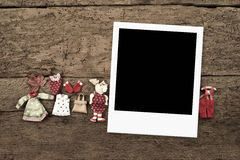 Christmas with three frames for photos. With Santa Claus dolls on a old wooden background Royalty Free Stock Photography
