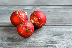 Christmas three red ball on a gray background Stock Images