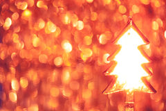 Christmas tree on shiny background. Christmas tree on shiny bokeh background with copy-space Royalty Free Stock Photo