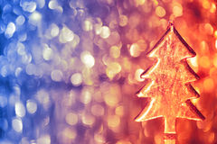 Christmas tree on shiny background. Christmas tree on shiny bokeh background with copy-space Royalty Free Stock Photos