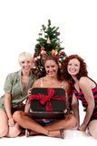 Christmas for three young attractive women Stock Images