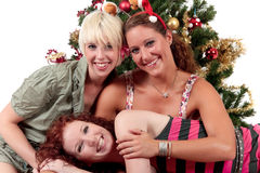 Christmas for three young attractive women Royalty Free Stock Photos