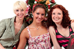 Christmas for three young attractive women Stock Image
