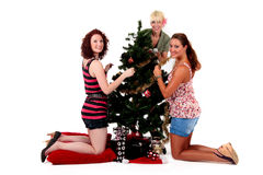 Christmas,three young happy women Royalty Free Stock Image
