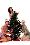 Christmas, three young happy women Stock Photos