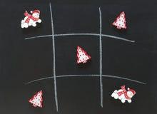 Christmas tic tac toe board game. Christmas background with tic tac toe board game Royalty Free Stock Photo